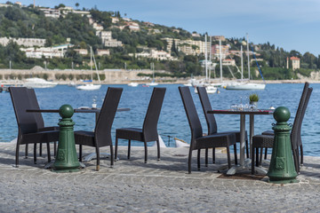 Restaurant tables positioned on the harbour edge