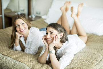 Young women on the bed
