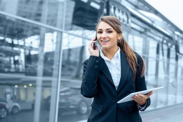 Successful businesswoman or entrepreneur using a digital tablet