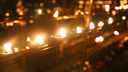 The view of burning candles in the Temple of the Tooth. It is a Buddhist temple located in the royal palace complex, which houses the relic of the tooth of Buddha.