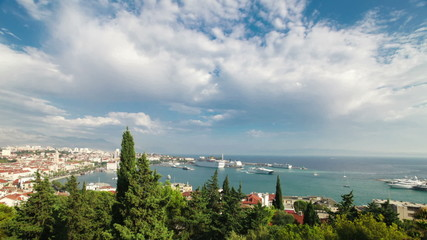 Timelapse of the bay of Split, Croatia. Fast moving clouds with boats and ferries trafficking in and out the port.
