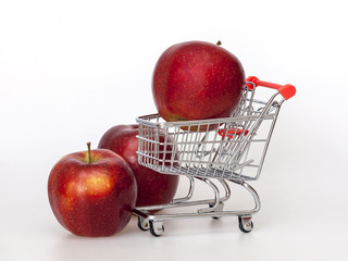 Large red apples in the store trolley