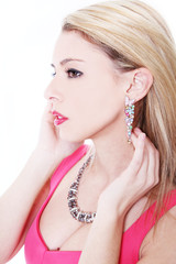 Sensual blonde with pink dress and jewelry