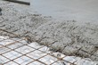 canvas print picture - Wet concrete cement flowing over rebar metal