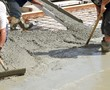 Workers pouring concrete - 81250706