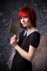 Red-haired girl with an ax