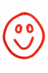 Happy Face Made Out Of Red Pipe Cleaners on White
