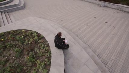 man sitting near the river