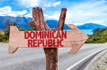 Dominican Republic wooden sign with road background