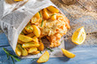 Delicious fish cod with chips with lemon - 81253175