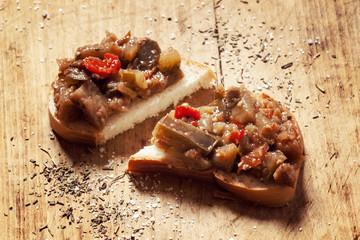 bread and Caponata Eggplant on a wooden board