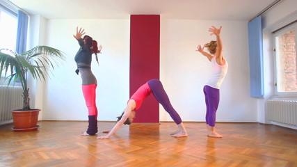Women doing yoga class in hall