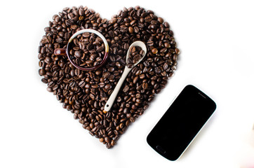 Coffe beans in the shape of a big heart with mug ,spoon & Mobile