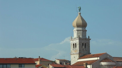 Bell tower and steeple of old town Krk in Croatia