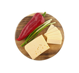 Vegetables and cheese on cutting board, isolated on white