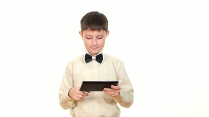 School boy looking for something using tablet computer, on white