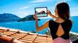 Woman traveler photographing St. Nikola island in Budva - 81256387