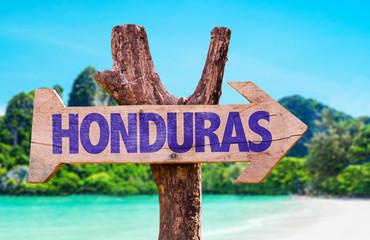 Honduras wooden sign with beach background