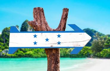 Honduras Flag wooden sign with beach background