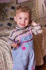Cute blonde baby girl with beautiful blue  smiling