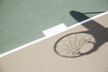 Shadow of Basketball Hoop and Net Against Court