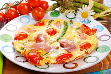 frittata omelet with asparagus,tomato and ham
