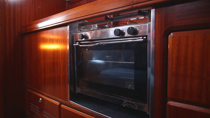 pendular oven in cabin of sail boat