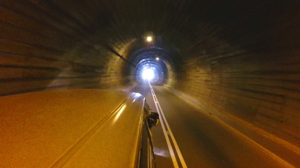 Vehicle driving through tunnel in Sri Lanka.