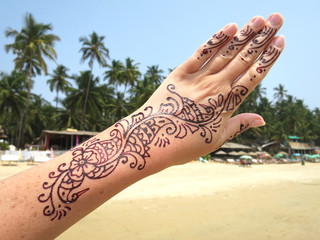 Henna tattoo on the arm. Palolem beach of South Goa, India