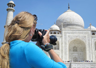 Girl taking a shot of Taj Mahal. Agra, India