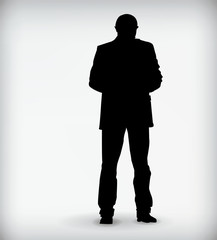 Silhouette of a man standing isolated on a white background