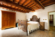 Bedroom with rustic wooden bed - 81258551