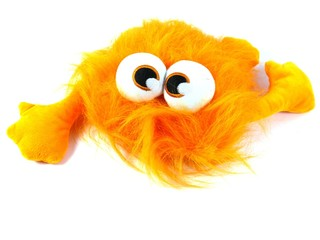 Orange toy monster with long hair and bulging eyes