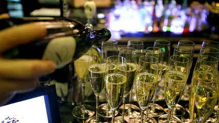 Glasses filled with champagne on bar counter