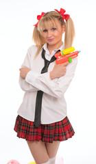 schoolgirl woman with water pistol