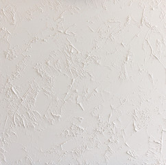 white abstract structured background wall with rough stucco patt