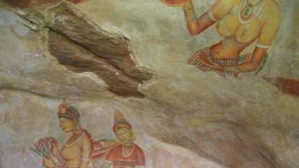 SIGIRIYA, SRI LANKA - FEBRUARY 2014: Wall drawing Frescos in Sigiriya, an ancient palace located in the central Matale District.