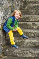 Portrait of a little  blond boy, wearing colorful clothes