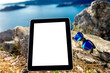 Digital tablet with sunglasses on the mountain