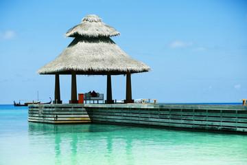 Boardwalk to arbor over blue ocean in Baros Maldives