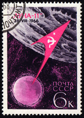 "Flight of soviet automatic spaceship ""Luna-11"" on post stamp"