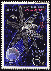 Postage stamp with communication satellite in space
