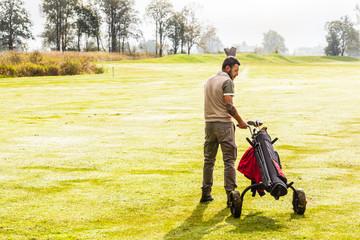 Walking golf player