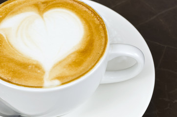 White cup of latte art
