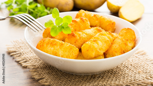 Fotobehang Klaar gerecht Kartoffelkroketten - potato croquettes