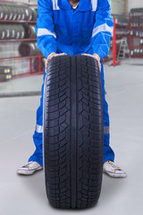 Mechanic changing a car tire