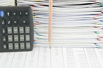 Pencil and calculator in vertical on finance report
