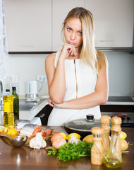 Housewife thinking what to cook for dinner