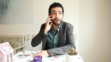 Handsome young man answering a call