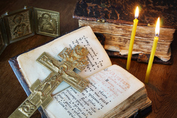 Orthodox Christian still life with metal crucifixion and book